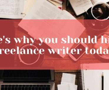 hire a freelance writer, coffee cup. open laptop, pen on a blank book, open books spread on a table