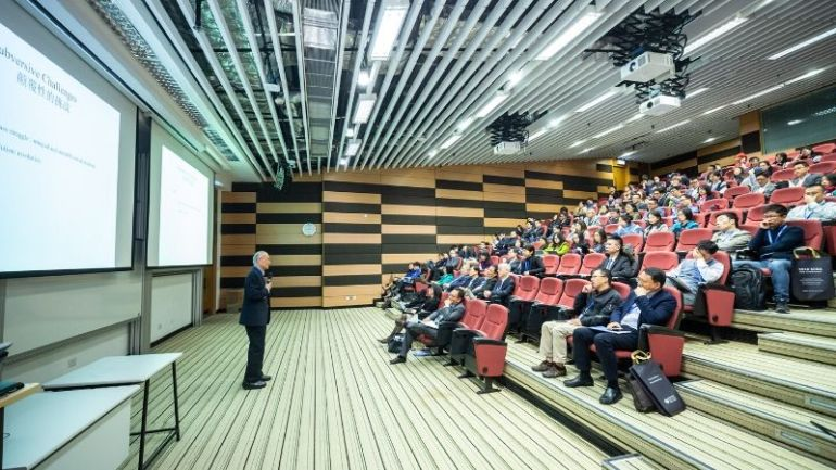 speaker in front of a hall of audience - planning a business events -plan successful Year-end event for your business