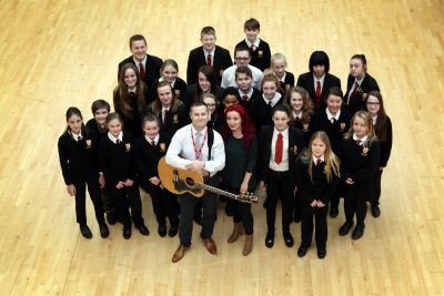 Aaron Bayley and Beth Macari with students at the Northumberland Church of England Academy
