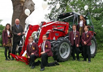 Howard Wood and students take delivery of the new Massey Ferguson tractor.