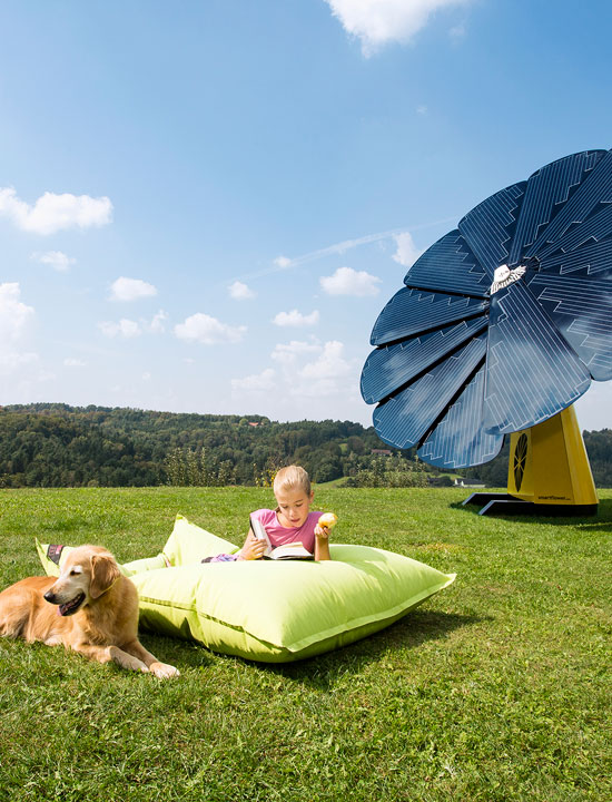 A Baby and a Dog Enjoy a Sunny Day Outside Next to a SmartFlower Solar Panel