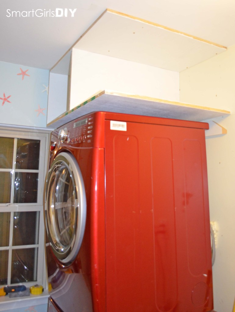 Smart Girls DIY blog - building custom shelf over stacked washer dryer how to