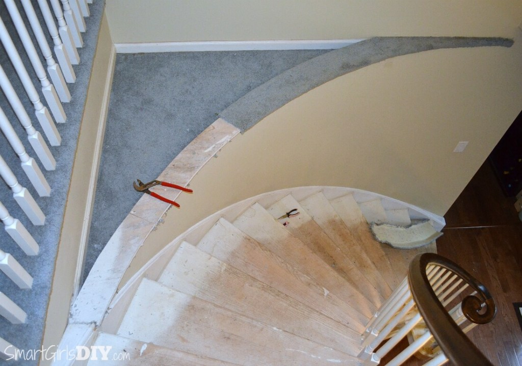 Tearing carpet off staircase platform