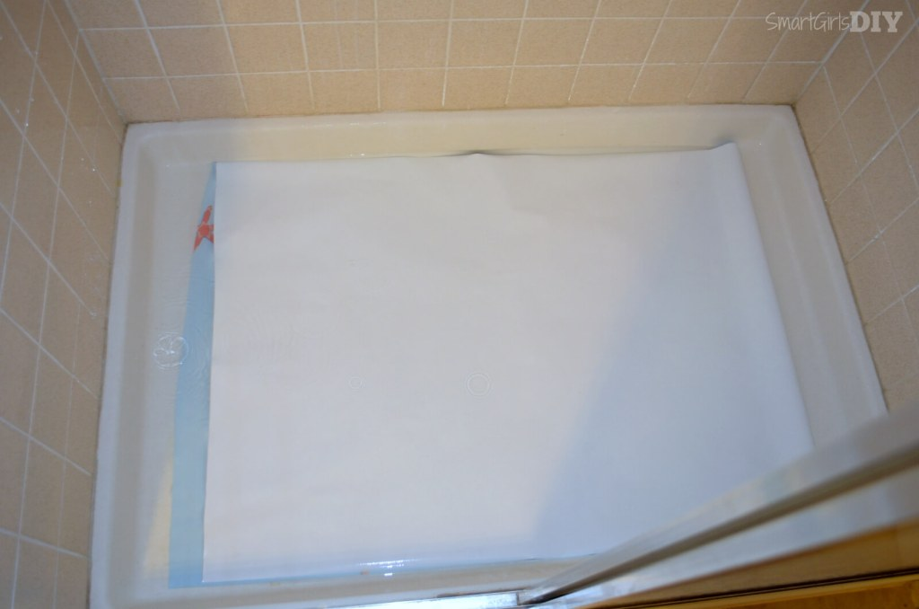 Soaking extra wide wallpaper roll in show pan -- worked like a charm
