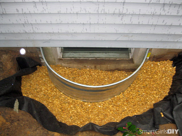 Window well installed - hole filled with pea gravel