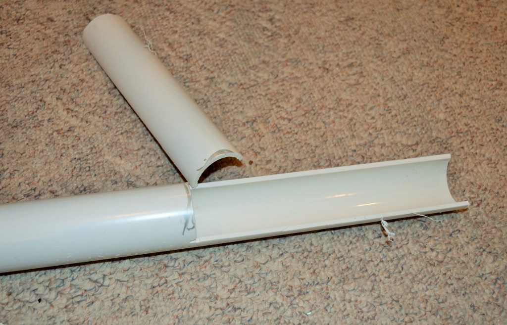 Cut off half of each end of the PVC to allow TV wires to to enter the tube
