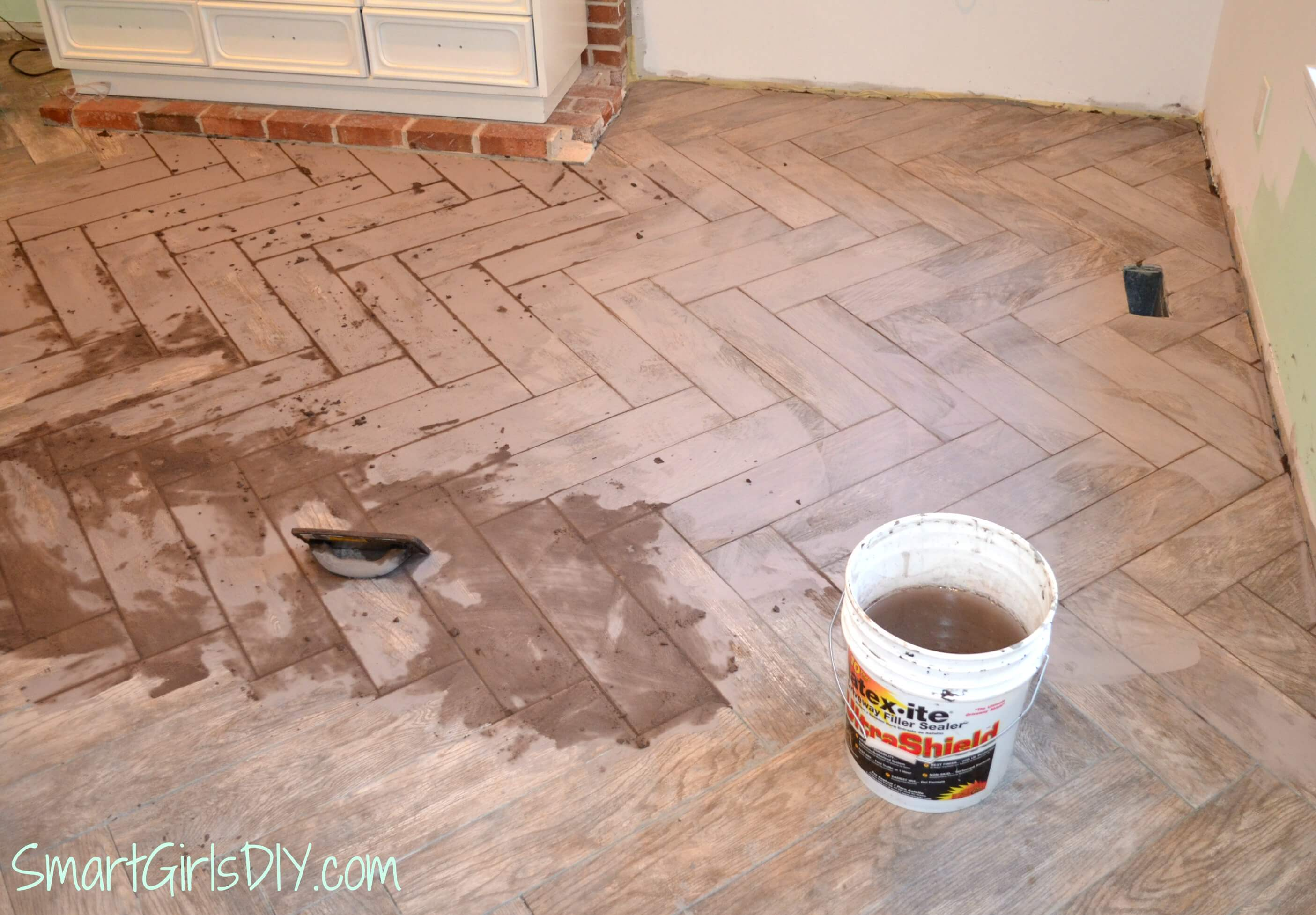 Grouting a herringbone tile floor family room 11 it was easy to grout but not so easy to clean up grouting herringbone tile floor diy dailygadgetfo Images