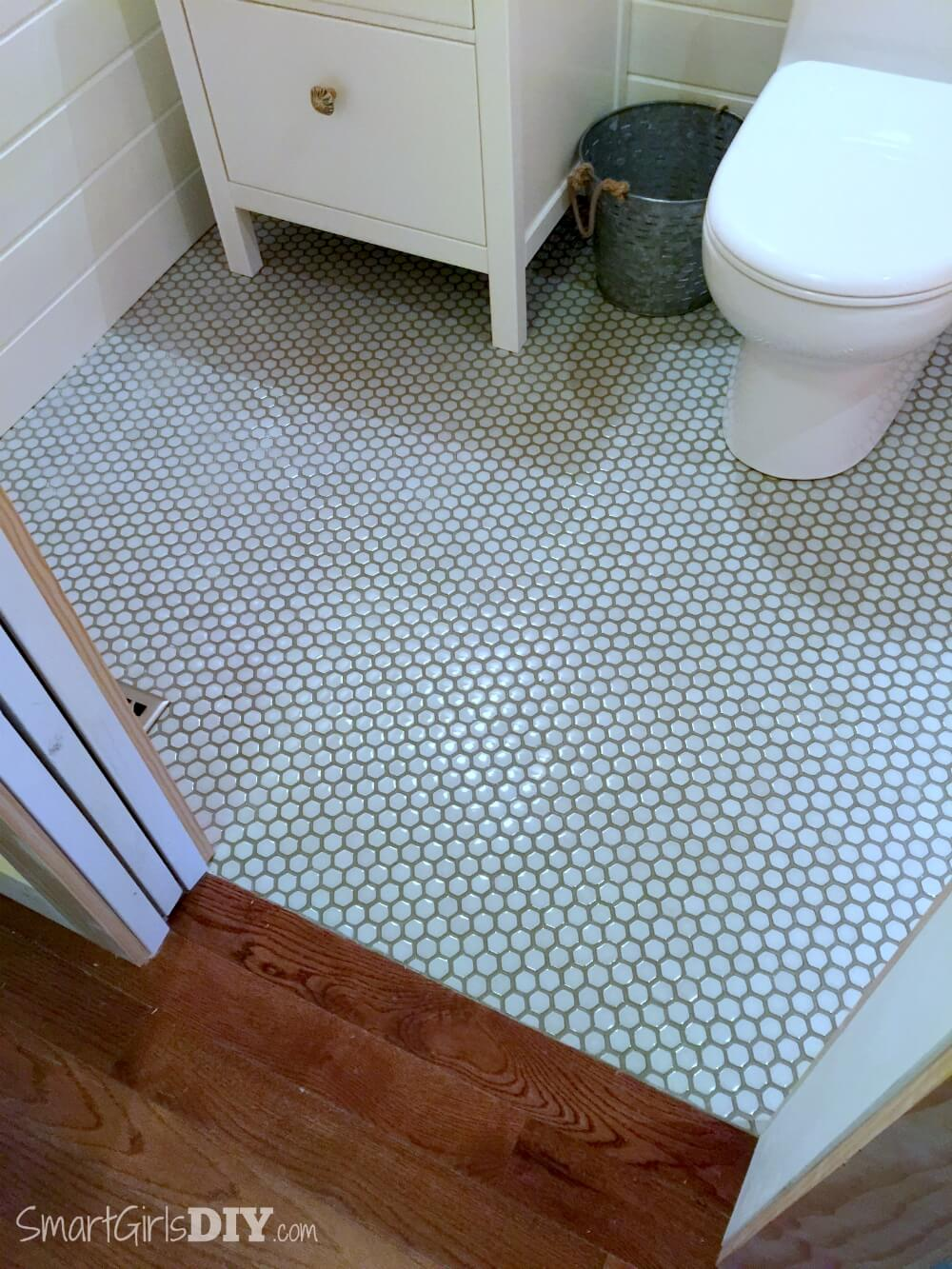 Guest bathroom 7 diy hex tile floor bathroom makeover hexagon floor tiles with painted grout lines transition to hardwood floor dailygadgetfo Images
