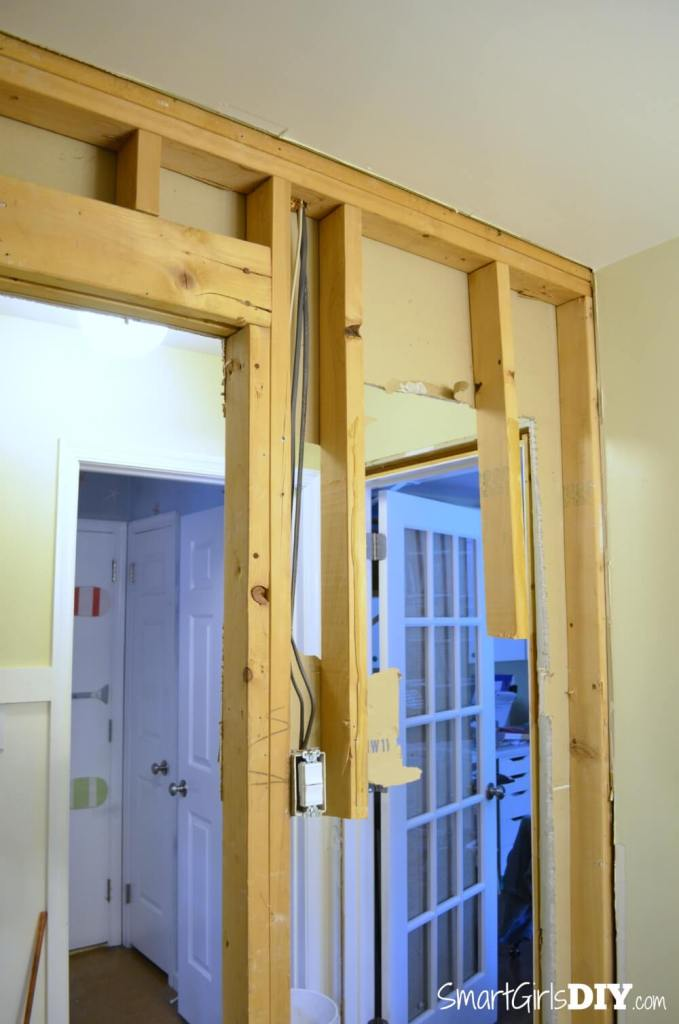 Studs partially removed to make room for pocket door frame