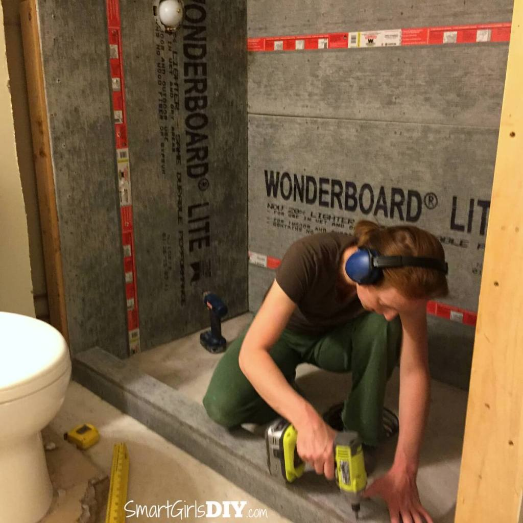 Shower curb made our of cement board and lumber