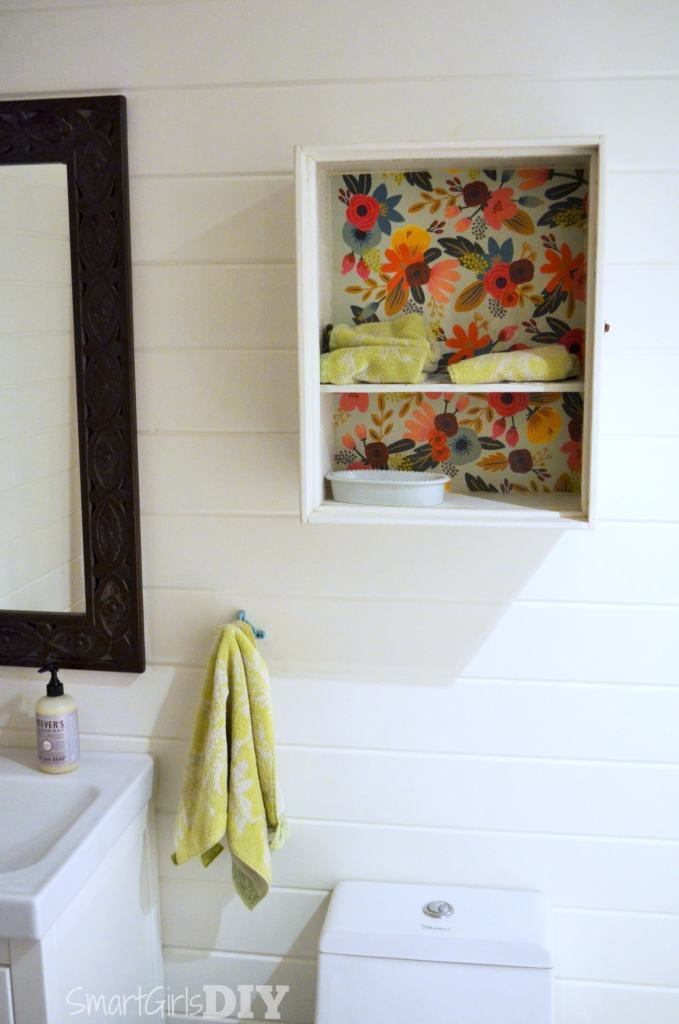 Mod Podge makeover on bathroom wall cabinet
