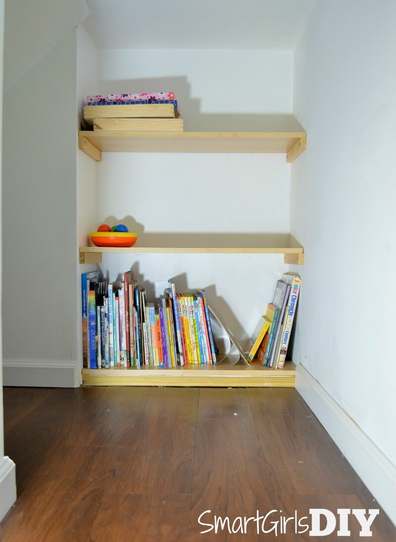 Never finished shelves under basement stairs