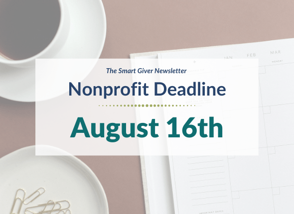 """A white paper planner, a coffee cup, and a tray with paper clips on a tan table. The text overlay reads """"The Smart Giver Newsletter Nonprofit Deadline: August 16th"""""""
