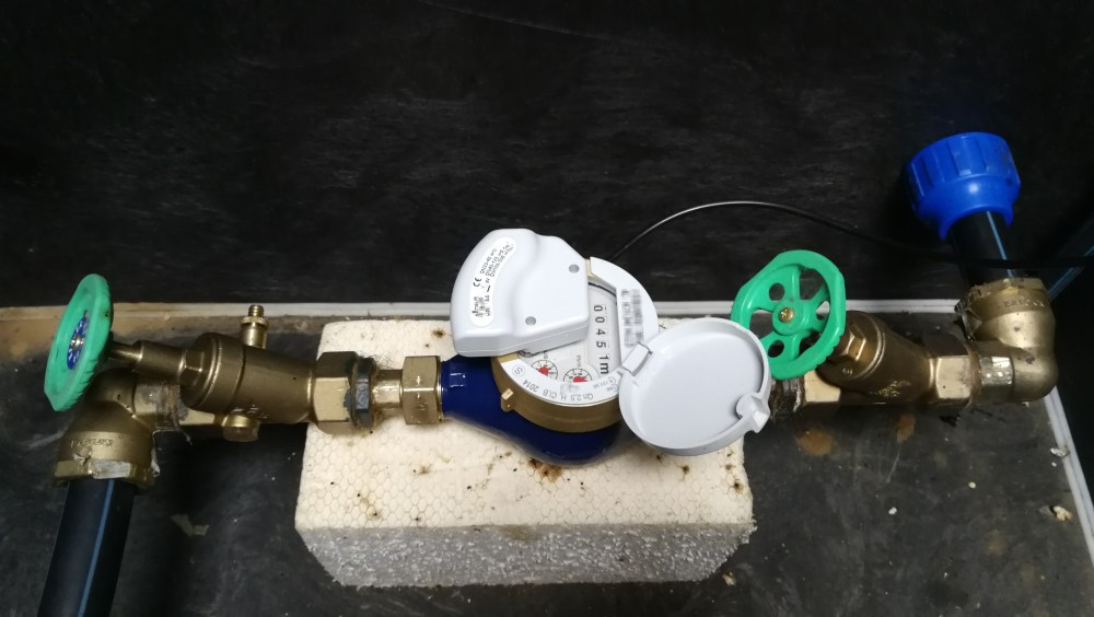 medium resolution of water meter with installed pulse reader on it