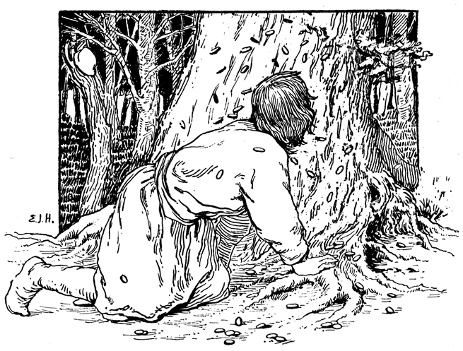 A youth crawls at the foot of a large tree.