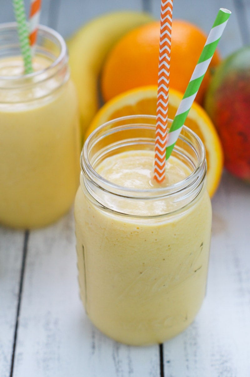 Tropical Sunrise Smoothie ~ A protein packed and refreshing smoothie filled with vitamins, probiotics, and lots of tropical tasting flavors!