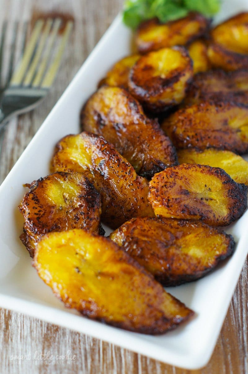 Golden Fried Sweet Plantain Slices (Platanos Maduros Fritos) served on a white plate.