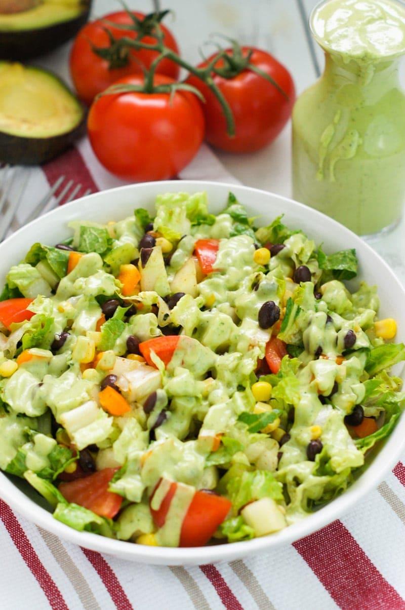 Avocado cilantro dressing drizzled over a salad plate.
