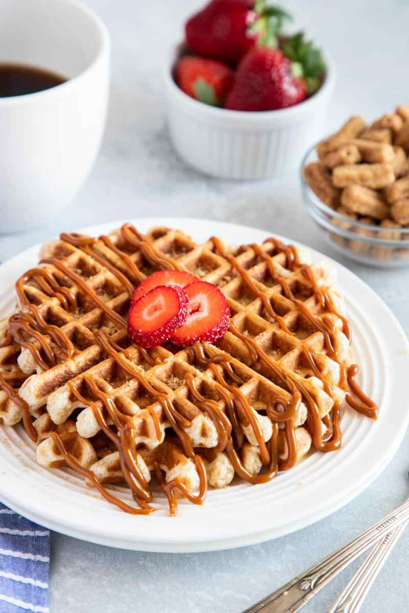 Churro Waffles with Dulce de Leche served on a plate