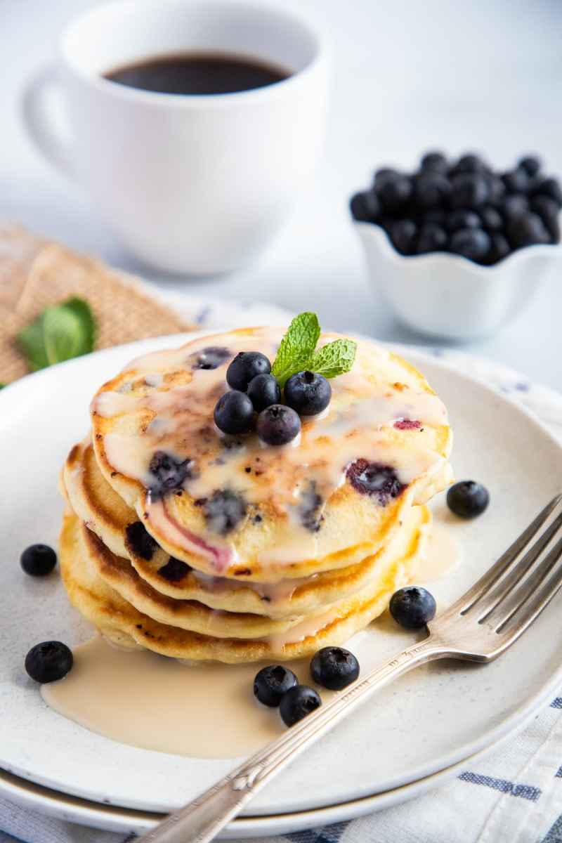 Blueberry Pancakes on a plate with vanilla glaze