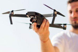 man-holding-drone