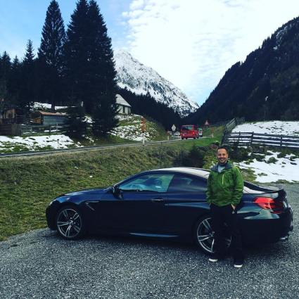 My sheepish mug in front of our rented BMW M6 on the Austrian autobahn