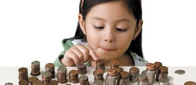 young girl stacking her pennies