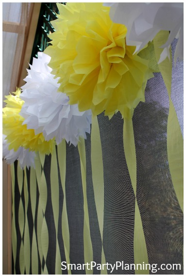 Yellow and white tissue paper pom poms
