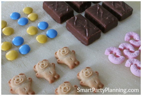"Need some easy kids party food ideas?  You can't get much easier than tiny teddy cars.  They are cheap and simple to make, plus look adorable!  Make them ahead of time to allow extra time for preparing things on the day.  The kids absolutely love them and are perfect for a birthday party celebration.  Follow the easy ""how to"" tutorial."