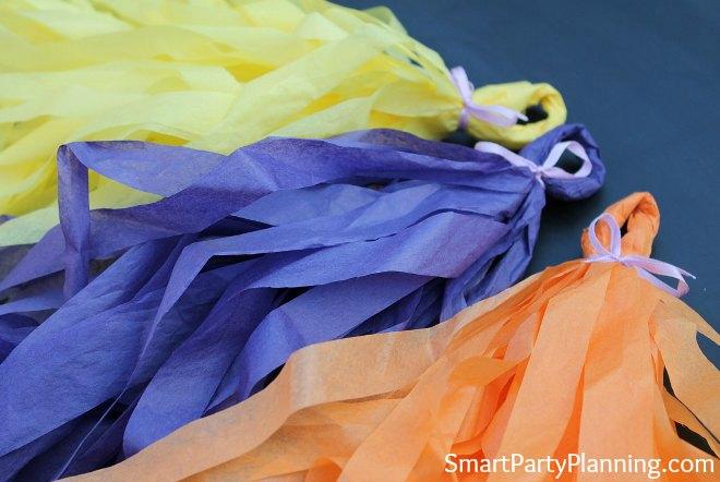yellow, purple and orange tissue paper garlands