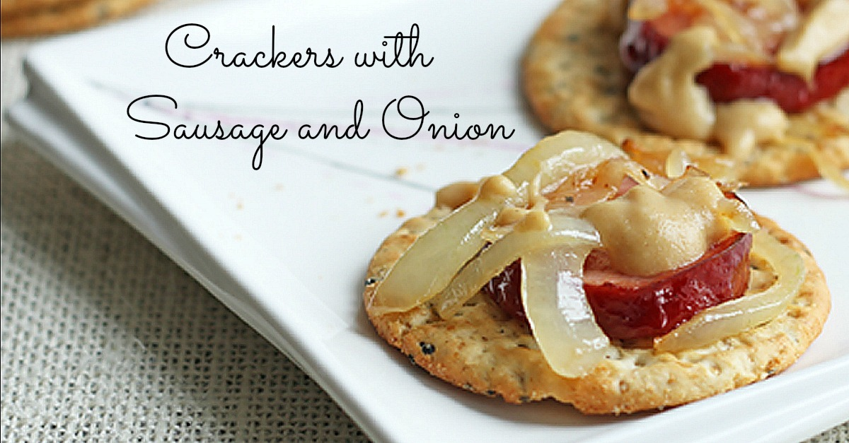 Crackers with sausage and onion