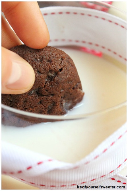 dunking mint chocolate chip cookie in milk