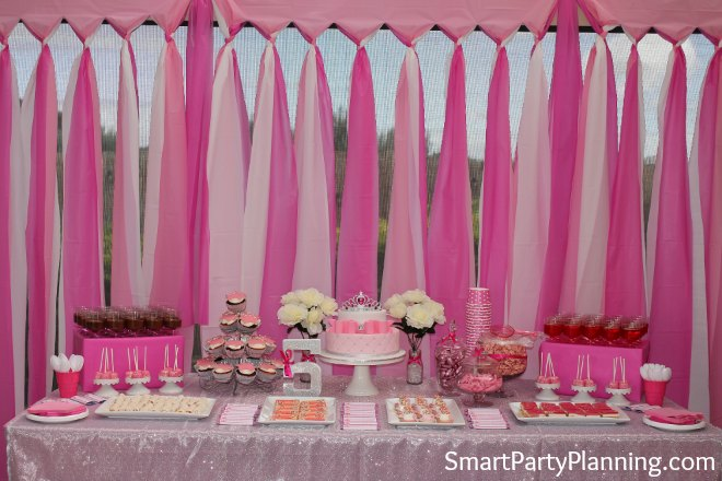 Set up a table with mementos and pictures from the life of the birthday guy or gal (graduations, wedding day, past birthdays).; A sign in where guests can leave birthday wishes is a fun element to add. You can set out an oversized birthday card, a guest book, or a personalized sign in board.