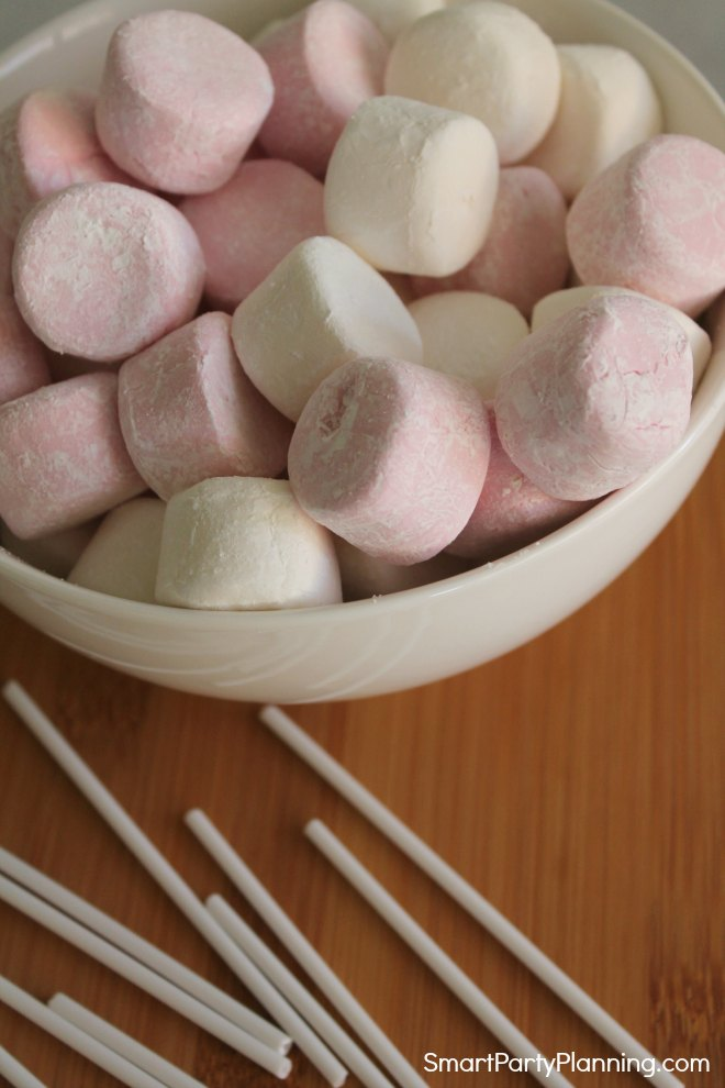marshmallows and cake pop sticks