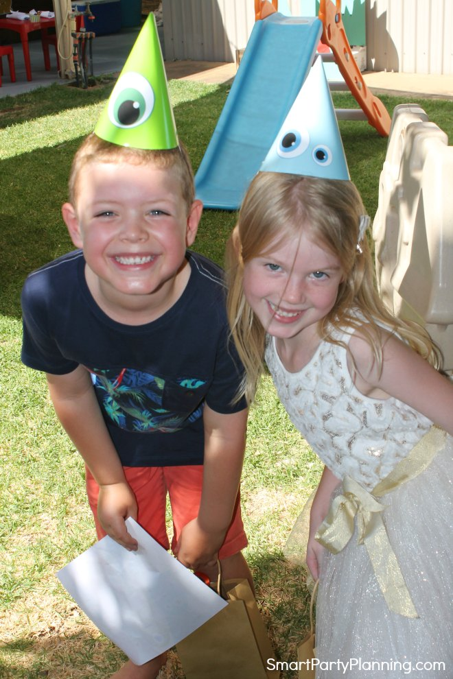 Kids wearing monster party hats