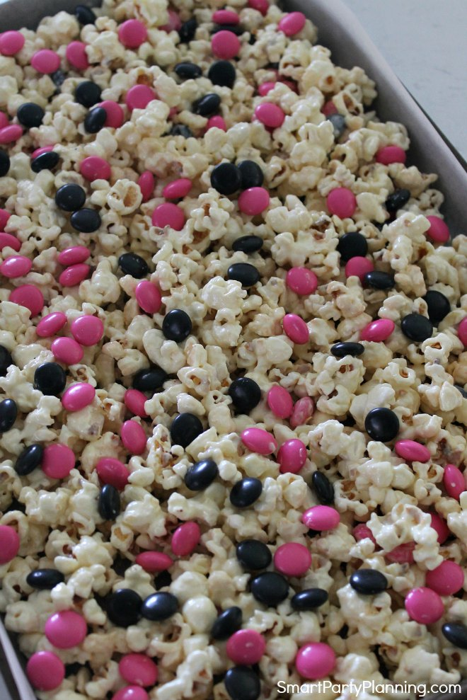 Cover popcorn with smarties