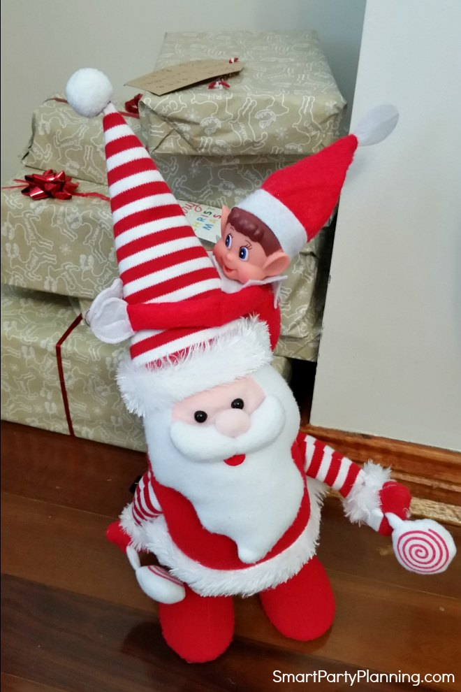 elf on the shelf playing with Santa