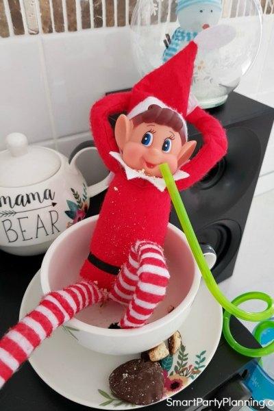 Elf eats cookies and drinks milk