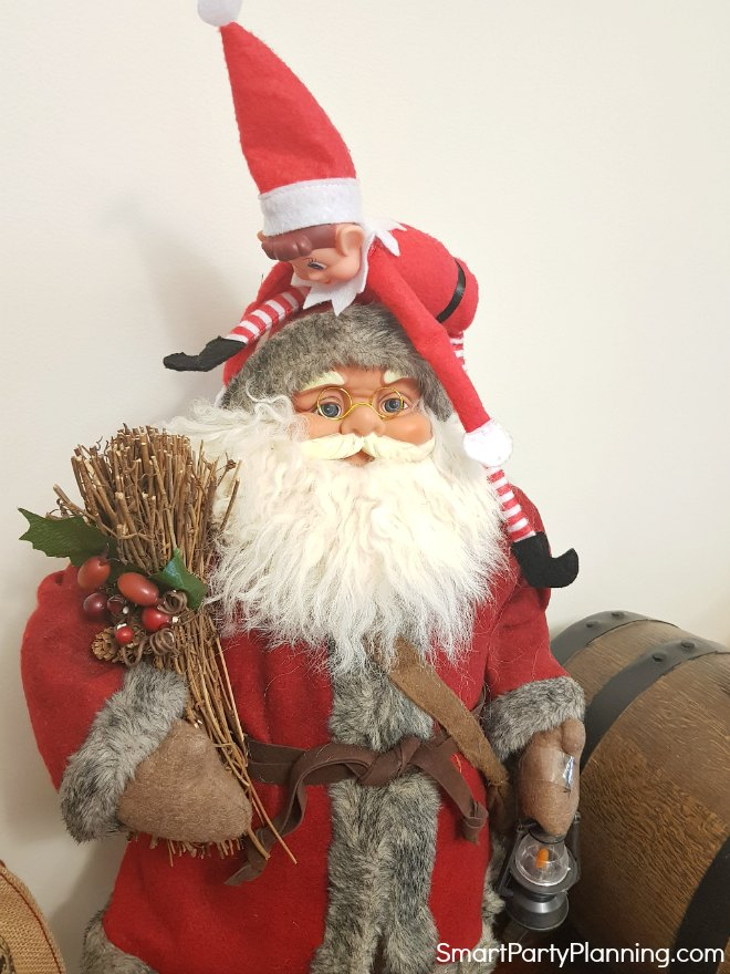 Elf on the shelf climbing on santa