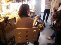 Emilie explains to students how she uses wax to make some of her jewelry.