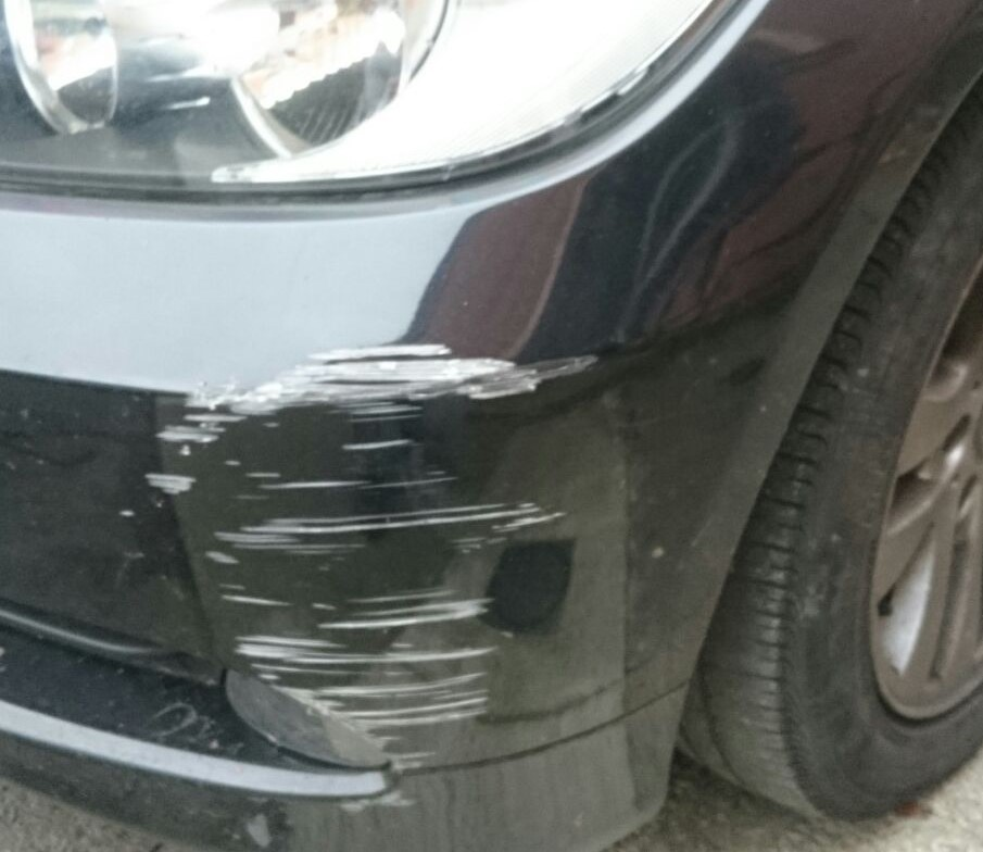 Image of a car requiring dent repair