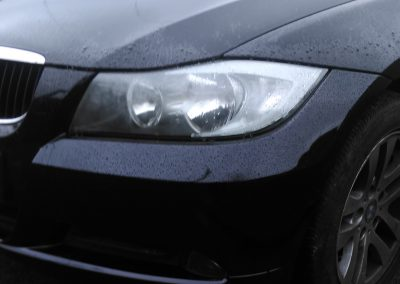 Repaired image of a BMW car with a bumper scuff