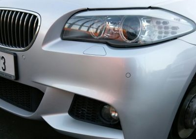 Image of a BMW car with a repaired bumper scuff