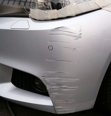 Image of a car requiring a bumper scuff repair