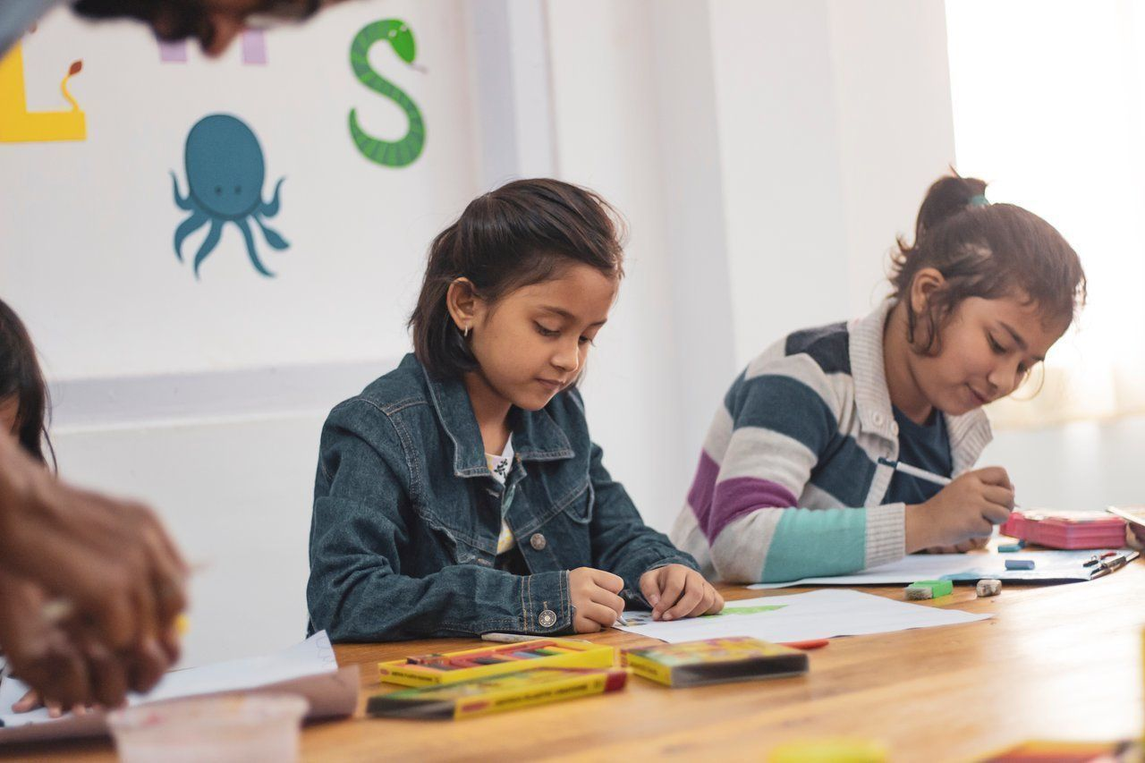 Two Girls Doing Schoolwork - A Smart Way To Start by Mara Catherine Harvey