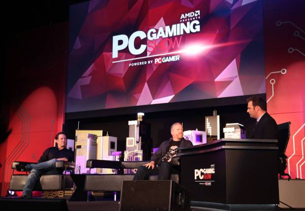 Phil Spencer, Head of Xbox, left, and Rod Fergusson, Studio Head of The Coalition, center, take the stage at the Xbox-sponsored PC Gaming Show at E3 on Tuesday, June 16, 2015 in Los Angeles. (Photo by Casey Rodgers/Invision for Microsoft/AP Images)