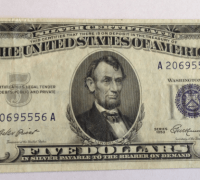 Silver Certificates circulated from 1878 to 1964 and were issued by the United States Treasury and enabled the holder to redeem them in exchange for silver bullion.
