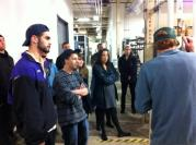 Students from Prof. Paul Olsen's class on tour at the Burton Snowboard plant in Burlington, VT