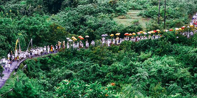 A Group of people walking up a trail in Bali