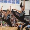 Varsity Lancer Dancers jump in synchronization to their performance.
